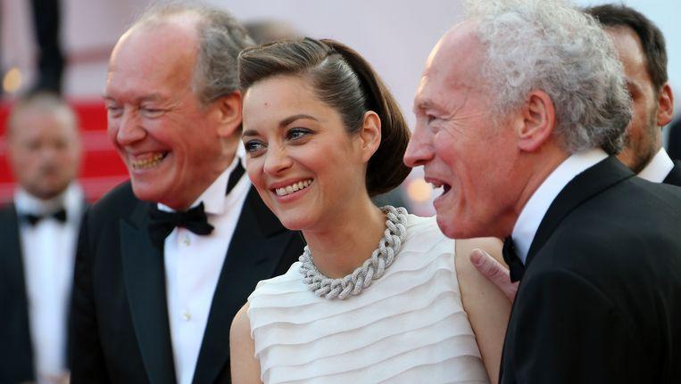De Franse actrice Marion Cotilaard met de broers Dardenne.