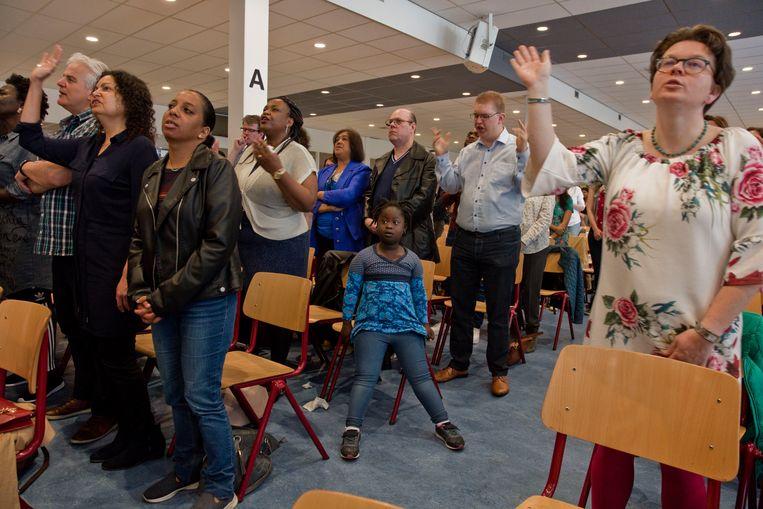 De International Christian Fellowship op een bijeenkomst in Rotterdam.  Beeld Otto Snoek