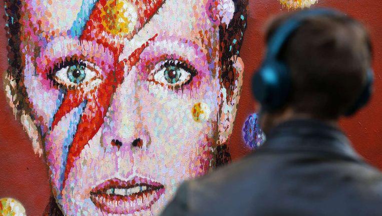 Een muurschildering in Brixton die twee dagen na de dood van Bowie gemaakt werd door straatkunstenaar James Cochran. Beeld anp