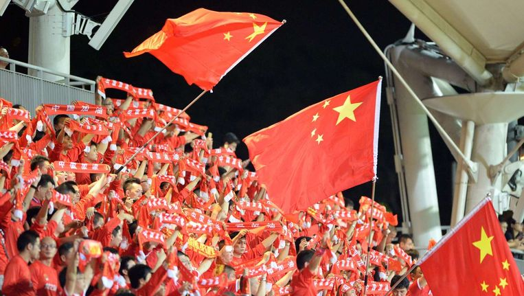 Chinese fans moedigen hun team aan Beeld ANP