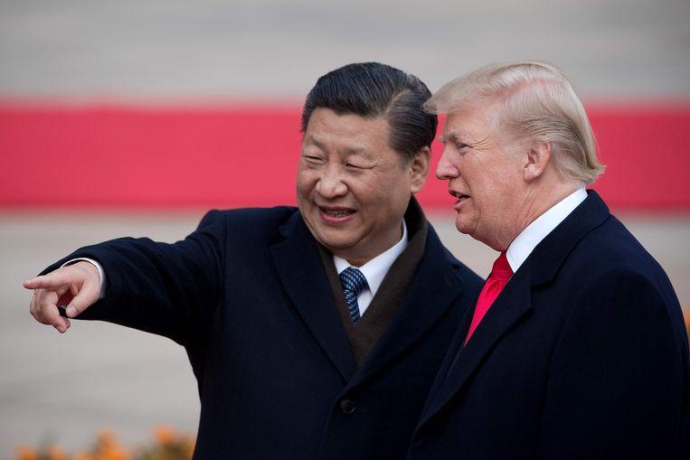 De Amerikaanse president Trump (rechts) samen met de Chinese president Xi Jinping in 2017.