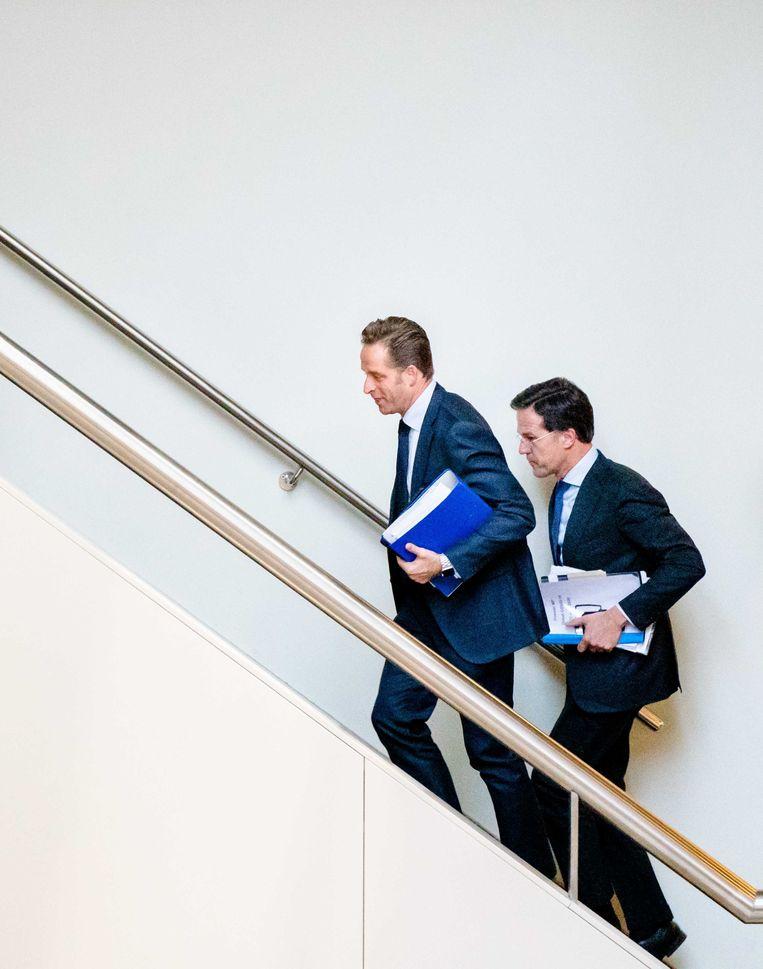 Minister De Jonge van Volksgezondheid, Welzijn en Sport (CDA) en Premier Rutte. Beeld ANP