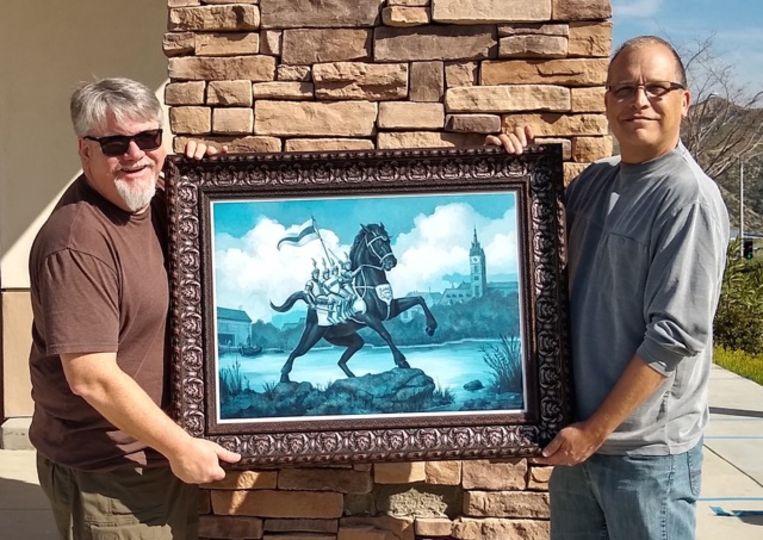 Peter Goossens en artiest John Zeleznik tonen samen trots de unieke illustratie van het Ros Beiaard.