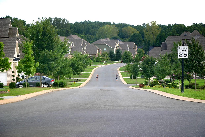 De 'gated community' Highclere, één van de vele rijke voorsteden rond Charlotte.  Beeld Michael Persson