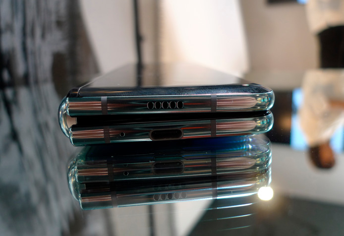 FILE - In this April 16, 2019, file photo, the Samsung Galaxy Fold phone is seen in its folded position during a media preview event in London. Some of Samsung's new $2,000 folding phones appear to be breaking after just a couple of days. Journalists who received the phones to review before the public launch say the Galaxy Fold screen started flickering and turning black before completely fizzling out.  (AP Photo/Kelvin Chan, File)