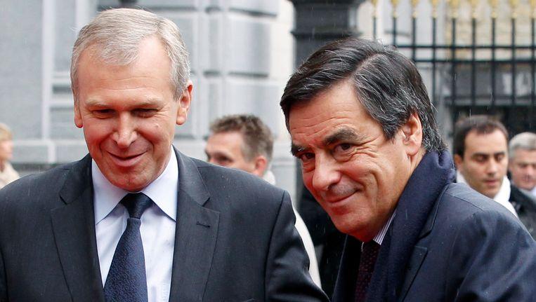 De Belgische premier Leterme (L) ontving gisteren zijn Franse collega Fillon in Brussel om de redding van Dexia af te ronden. Beeld REUTERS