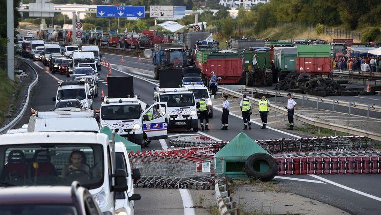 Een blokkade op de A6 ten noorden van Lyon. Beeld anp