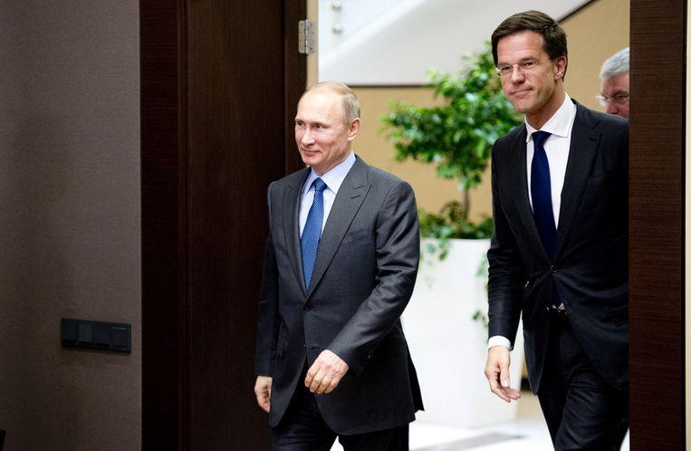 Premier Mark Rutte (R) tijdens zijn ontmoeting met de Russische president Vladimir Poetin, voorafgaand aan de opening van de Olympische Spelen. Beeld anp
