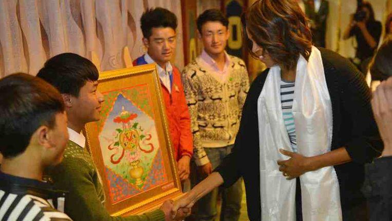 Michelle Obama in het Tibetiaanse restaurant. Beeld reuters