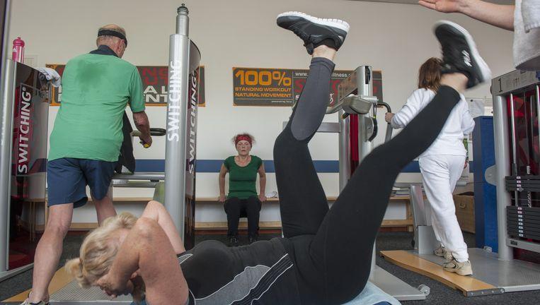 Een sportschool in Soest. Volgens onderzoek gebruikt het lichaam van een actief persoon minder energie voor de 'basisstofwisseling'. Je gebruik je dus evenveel energie bij méér inspanning. Beeld Hollandse Hoogte