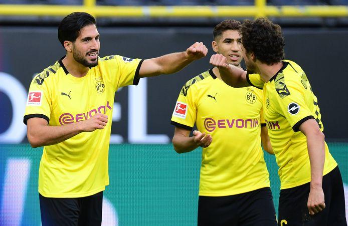 Emre Can (l) hielp Dortmund aan de overwinning.
