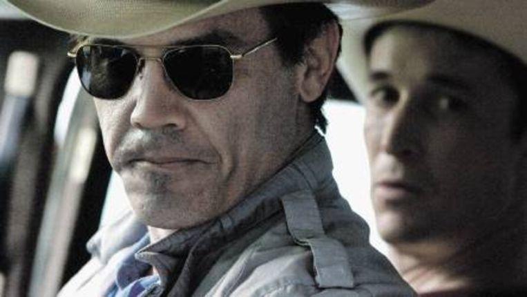 In 'W' wordt Bush neergezet als de simpele cowboy die zelf niet doorheeft dat hij tekortschiet. (Trouw) Beeld