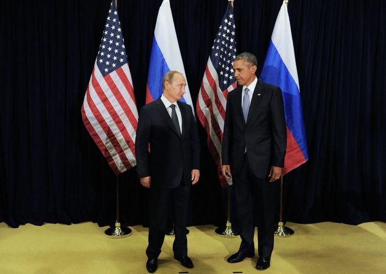 President Valdimir Poetin en president Barack Obama in New York op 28 September 2015. Beeld null