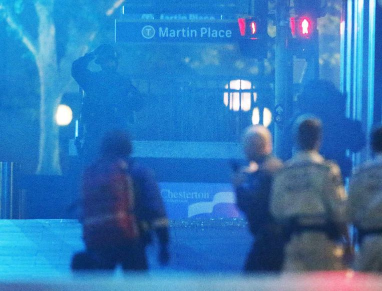 Beeld van de politie tijdens de bestorming van het café. Beeld reuters