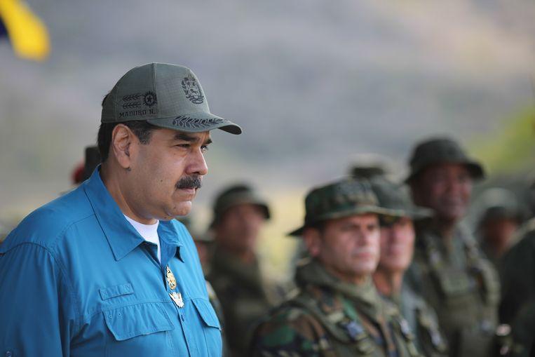 President Nicolas Maduro zondag tijdens een bijeenkomst met militairen in Turiamo, Venezuela. Beeld EPA
