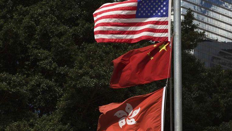 De vlag van de VS, China en Hongkong Beeld reuters