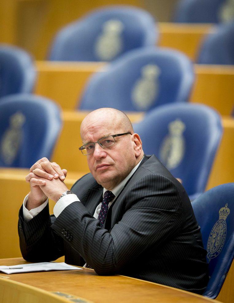 Fred Teeven tijdens het wekelijkse vragenuurtje in de Tweede Kamer. Beeld anp