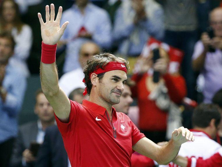 Roger Federer juicht na zijn overwinning tegen Thiemo de Bakker. Beeld reuters