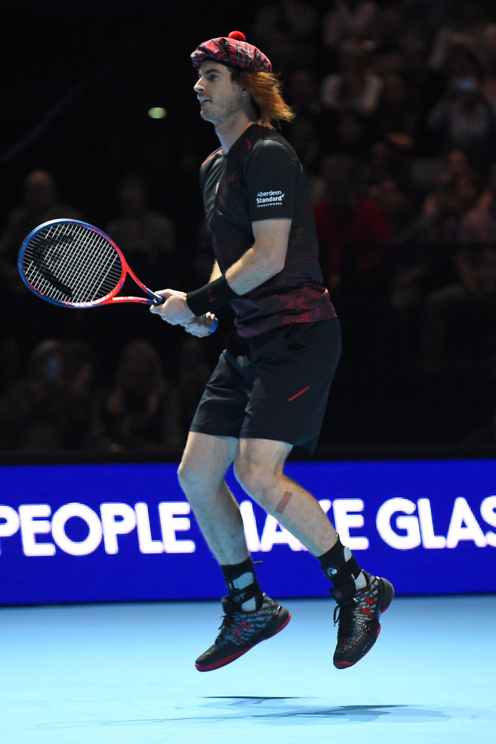 "Britain's Andy Murray wears a tartan hat as he plays Switzerland's Roger Federer in their exhibition tennis singles match, during ""Andy Murray Live"" at the SSE Hydro in Glasgow, Scotland on November 7, 2017.  ""Andy Murray Live"" is a charity fundraiser. Glasgow based charity, Sunny-sid3up, join Unicef as charity partner this year. / AFP PHOTO / Andy BUCHANAN"