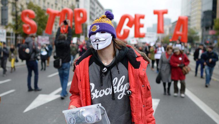 Demonstranten protesteren tegen CETA. Beeld epa