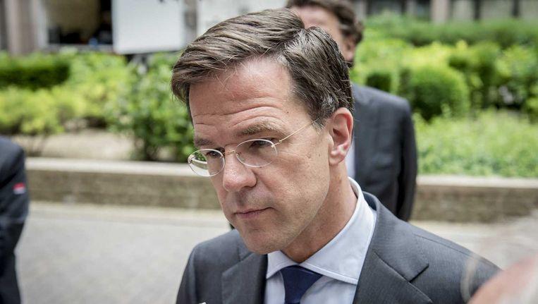 Premier Mark Rutte staat de pers te woord voor aanvang van de eurotop. Beeld anp