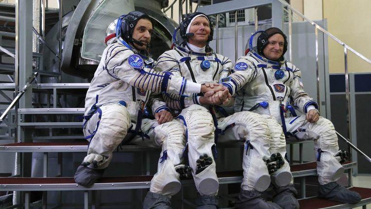 Mikhail Korniyenko, Gennady Padalka en Scott Kelly vertrekken op 28 maart. Beeld reuters