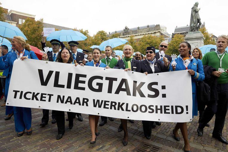 In 2013 demonstreerden medewerkers van KLM, Transavia en Martinair in Den Haag tegen de vliegtaks.  Beeld ANP