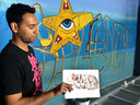 Steven Hopman met het ontwerp voor zijn werk bij de Graffiti Jam van vorig jaar