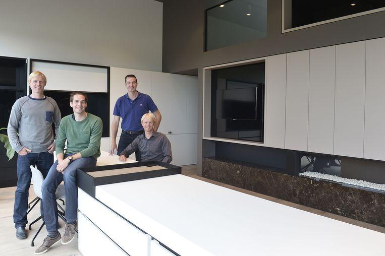 De broers Veldeman tonen trots hun nieuwe bedrijfsruimtes.