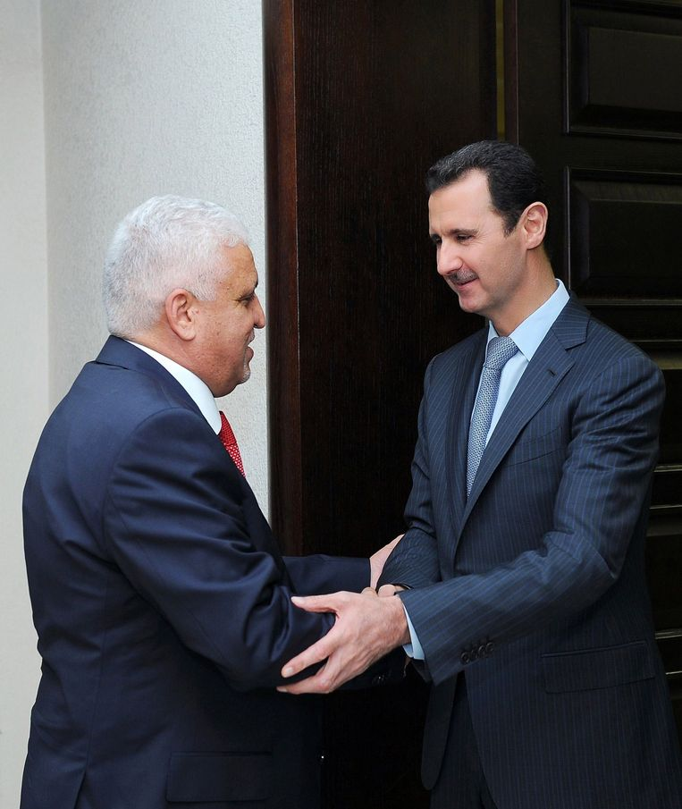 De Syrische president Bashar al-Assad met de Iraakse veiligheidsadviseur Faleh al-Fayyad. Beeld null