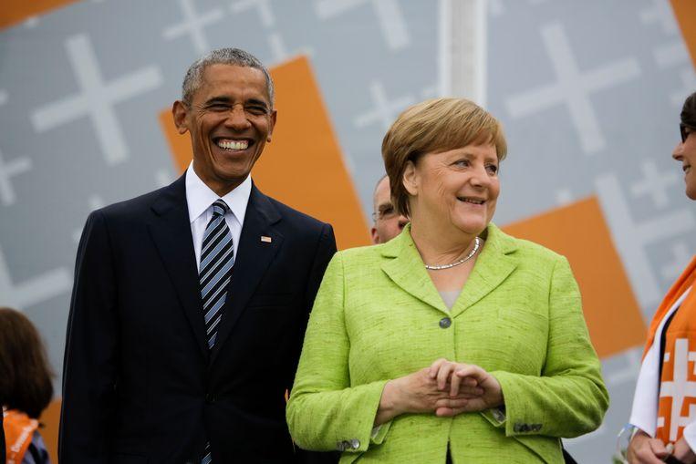 Hij in vlotte snit, zij in vrolijk lichtgroen. De leiders van de vrije wereld, zoals wij − en zij − het gewend waren. Beeld AP