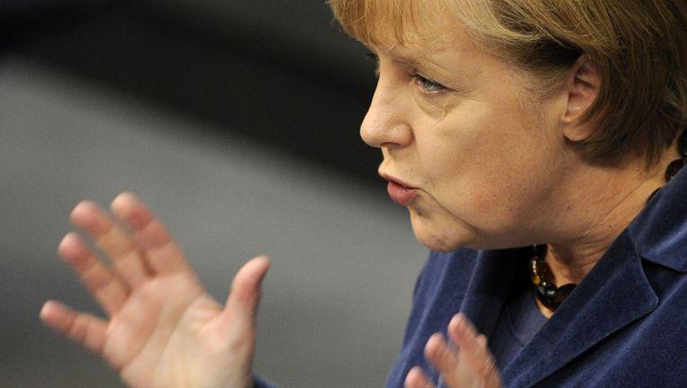 Angela Merkel tijdens haar speech voor de Duitse Bondsdag. Beeld afp