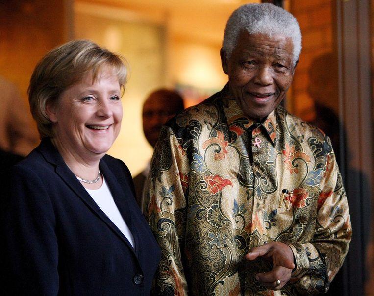 Mandela en Merkel in 2007. Beeld afp