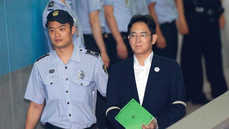 Lee Jae-yong arriveert bij het proces. Beeld afp
