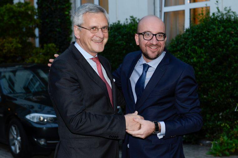 Michel en co-formateur Kris Peeters. Beeld belga