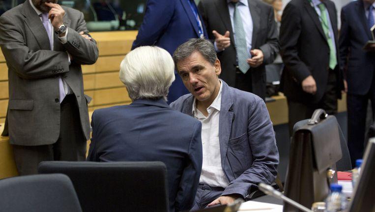 De Griekse minister van Financiën Tsakalotos in gesprek met IMF-topvrouw Christine Lagarde. Beeld ap