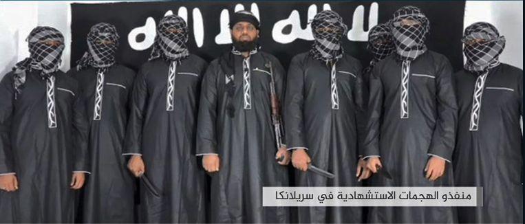 De acht mannen die verantwoordelijk zouden zijn voor de aanslagen met Pasen, volgens Amaaq, het propagandakanaal van IS. Beeld AFP