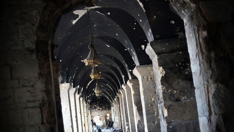 Een met kogels doorzeefde moskee in Aleppo, Syrië.
