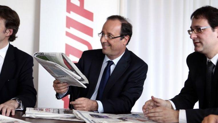 De Franse presidentskandidaat Francois Hollande (midden). Beeld afp