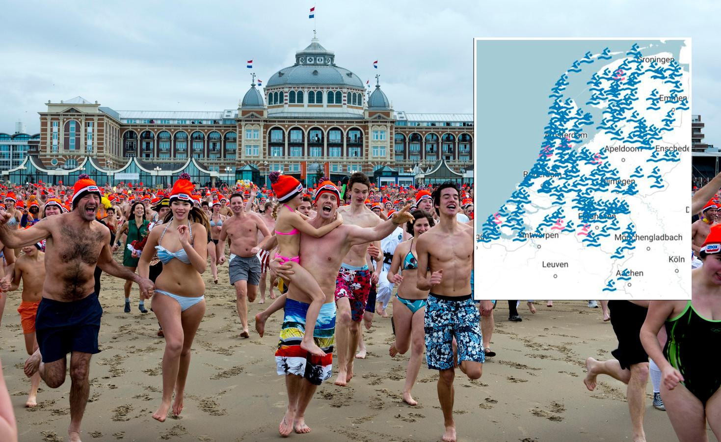 Deelnemers rennen de Noordzee in voor de traditionele nieuwjaarsduik in Scheveningen.