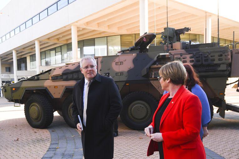 De Australische premier Scott Morrison en Minister van Defensie Linda Reynolds.  Beeld Lukas Coch/EPA