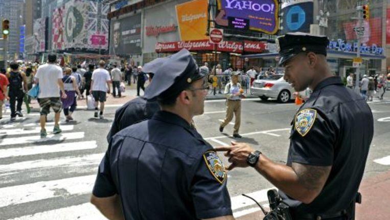 Amerikaanse politieagenten patrouilleren op Times Square. Foto ANP Beeld