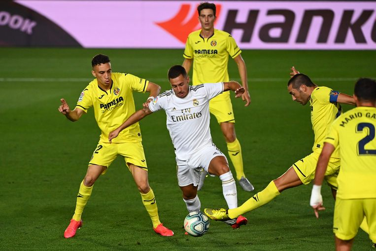 Villarreal's Spanish midfielder Bruno Soriano (2R) challenges Real Madrid's Belgian forward Eden Hazard (C)  during the Spanish League football match between Real Madrid CF and Villarreal CF at the Alfredo di Stefano stadium in Valdebebas, on the outskirts of Madrid, on July 16, 2020. (Photo by GABRIEL BOUYS / AFP)