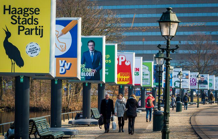 Billboards voor de afgelopen gemeenteraadsverkiezingen in Den Haag. Beeld ANP