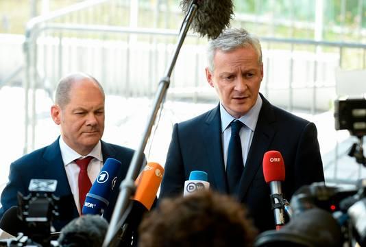De Duitse minister van Financiën Olaf Scholz (links) en zijn Franse collega Bruno Le Maire.
