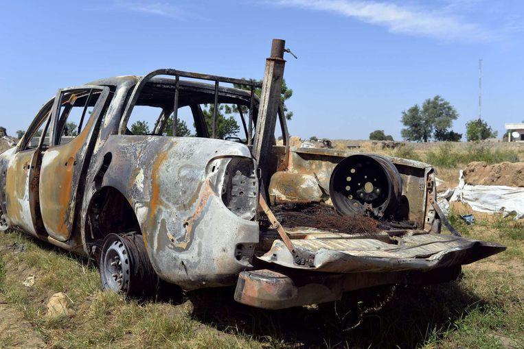 Een door het Nigeriaanse leger vernietigde Boko Haram-auto. Beeld afp