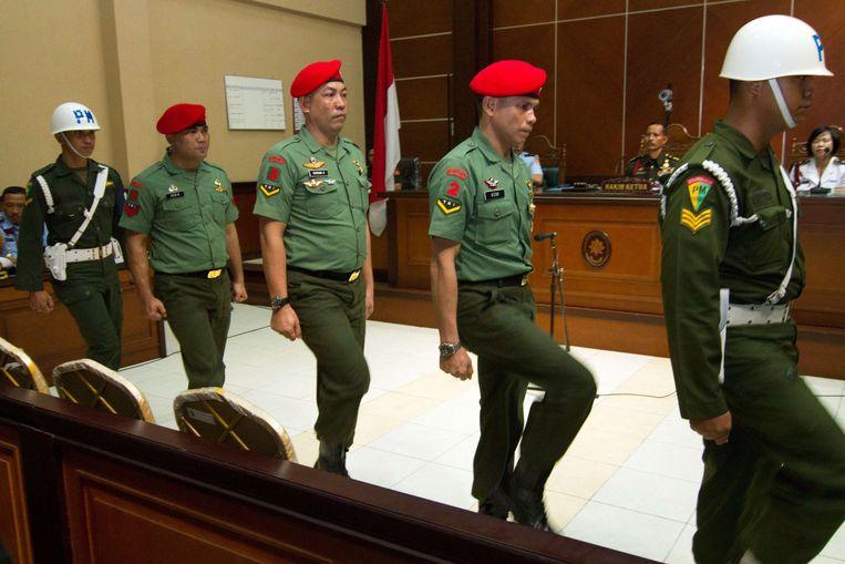 Soldaten in een Indonesische rechtszaal. Beeld AFP