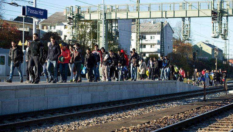 Vluchtelingen op een station in Keulen. Beeld epa