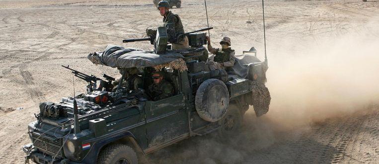Nederlandse special forces op patrouille in Afghanistan, bij Tarin Kowt in 2009. Beeld Ton Koene