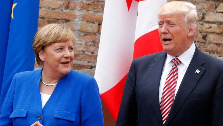 Angela Merkel en Donald Trump op Sicilië bij de G7-top. Beeld afp